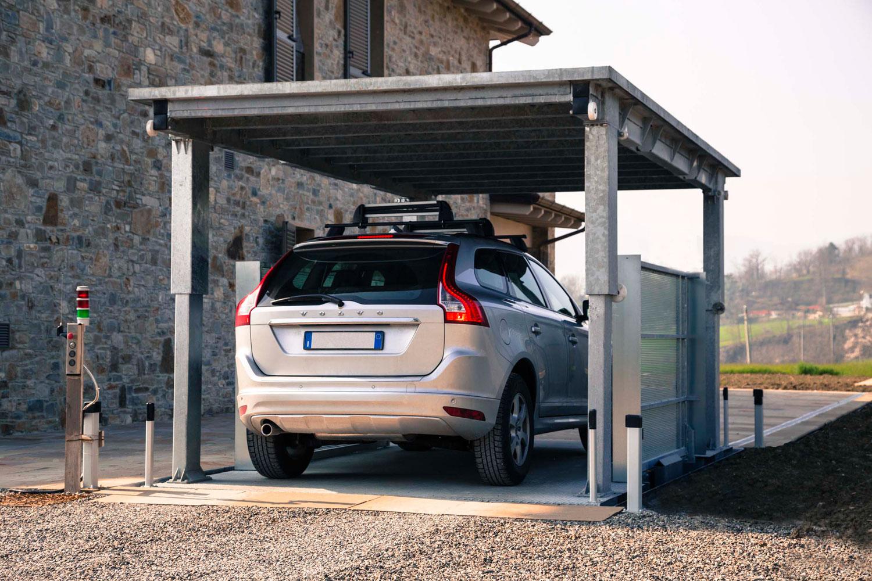 Ascensore per auto duo box mod c1s mbm parking system for Piani di caverna di garage uomo