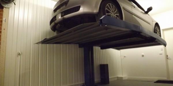 Raddoppiatore DUO BOX Mod. MCL sistema per parcheggio auto senza fossa a comando elettrico con movimentazioni oleodinamiche a due posti sovrapposti inseribile in qualsiasi ambiente senza alcun bisogno di opere murarie